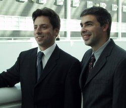 Picture of Larry Page and Sergei Brin in Suits