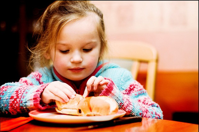 girl playing with her food