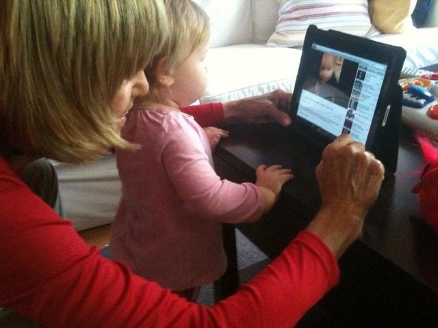 Mother & daughter watching videos on YouTube on an